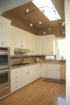 Kitchen Remodel with custom moulding, granite countertop and tile backsplash