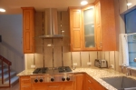 Unique backsplash and wall tile, combined with beautiful countertop