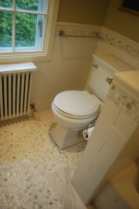 Antique style floor tiles match the bathrooms style