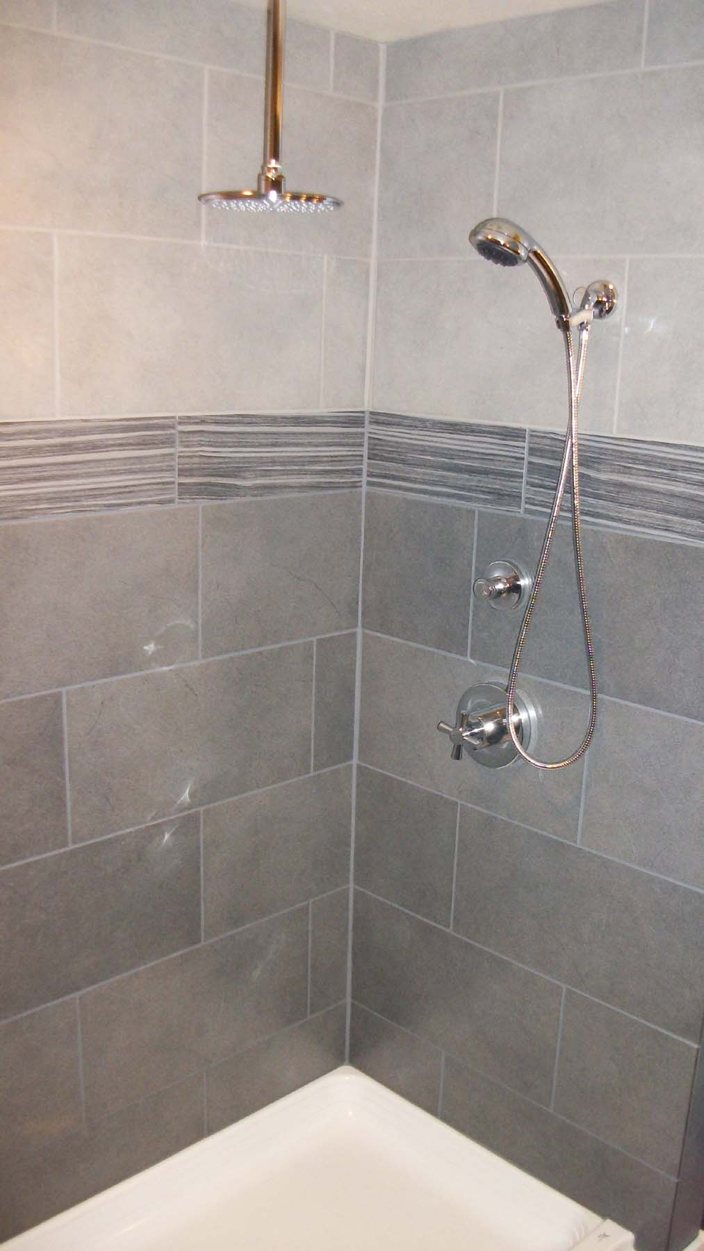 Wonderful shower tile and beautiful lavs notes from the for Bathroom grey tiles ideas