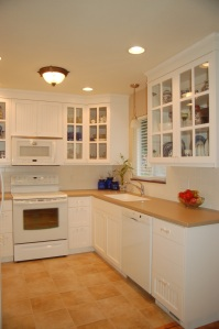 Light colored cabinets and glass fronted doors