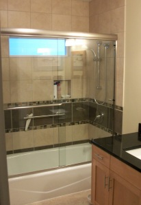 tiled tub/shower surround with glass shower doors