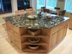 Corian countertop, drawers, cabinets and bar make this island a great addition to the kitchen.