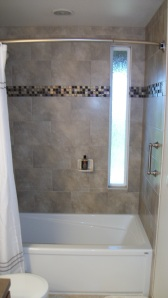 Tub/shower with custom tile and curved shower rod