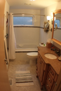 Note the curved shower rod; this is a popular option for those choosing not to go with a glass shower door.