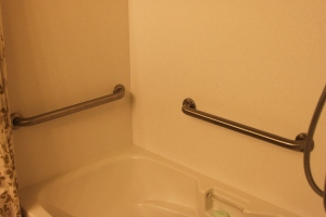 Two more grab bars add to the safety of this tub